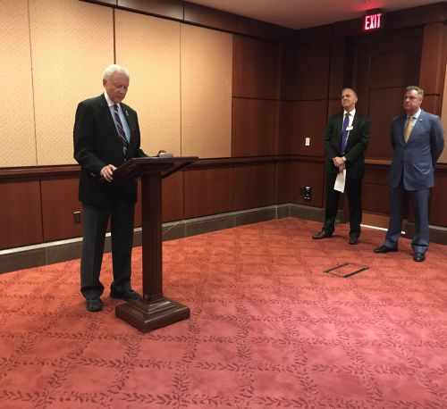 Senator Orrin Hatch (R-UT) addresses the room. ACTION for Trade Executive Director Brian Pomper and Congressman Scott Peters (D-CA) listen to the side